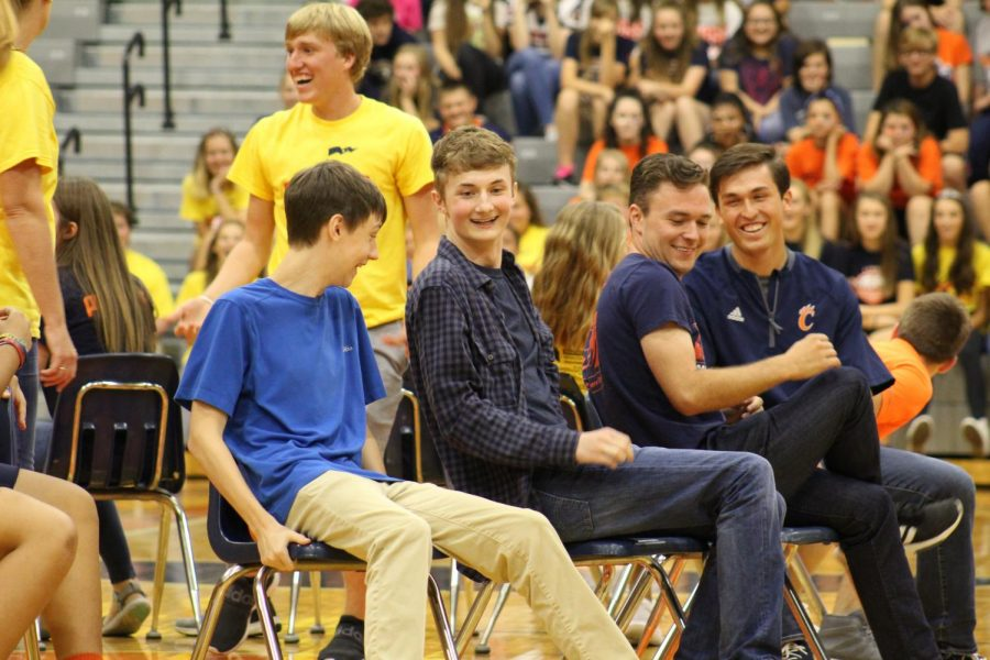 New+Teachers%2C+Mr.+Coleman+and+Mr.+Towers+join+in+on+the+fun+during+an+epic+battle+of+musical+chairs+while+attending+our+homecoming+pep+rally.+