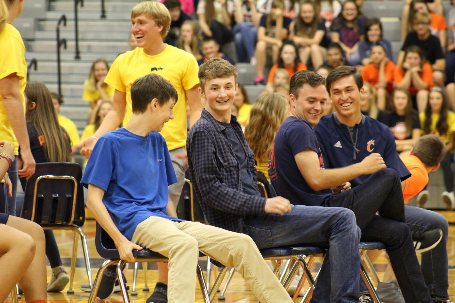 New Teachers, Mr. Coleman and Mr. Towers join in on the fun during an epic battle of musical chairs while attending our homecoming pep rally.
