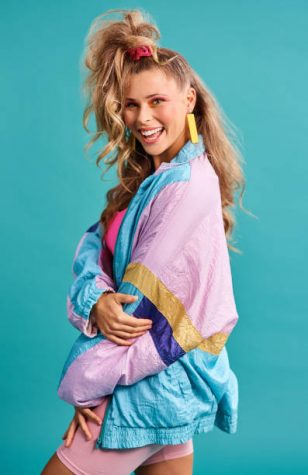 Studio shot of a beautiful young woman wearing a 80s outfit